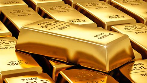 Золото дешевеет на фоне удорожания доллара