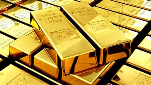 Золото незначительно дорожает  на фоне ослабления доллара