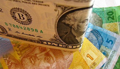Доллар вырос до57, 7 рубля