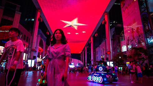 Китайские компании продают зарубежные активы на фоне опасений по поводу возможной нехватки долларов